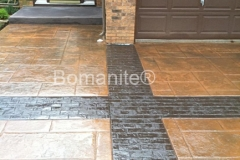 Bomanite Imprint Systems with Bomacron-Textured and Pattern Imprinted Concrete using Large Ashlare Stone and Running Bond Used Brick on a residential driveway in Minnesota.