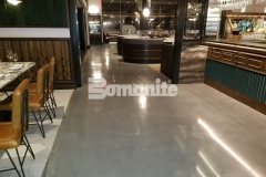 With Michael Symon's ode to classic Italian food at his restaurant, Angeline, the design aesthetic needed to reflect a balance of old and new world styles and this was beautifully captured using Bomanite Modena SL polished concrete flooring.