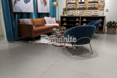 """Bomanite Modena SL was utilized here to create a 3/8"""" thick custom polished concrete overlay and will provide a low maintenance surface with a warm gray tone and sating finish that enhance the refined design aesthetic at the Nickel & Suede flagship store."""