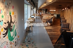 This decorative concrete overlay was created using Bomanite Modena SL integrally colored concrete that was ground and polished to a highly durable finish and a portion of this stunning flooring serves as a beautiful canvas for a colorful mural that is reflective of the unique character of this Kansas City community.