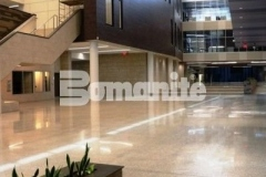 Over 25,000 SF of two-inch thick Bomanite Renaissance Deep Grind polished concrete was installed at Olathe West High School by our associate Musselman & Hall Contractors, LLC with deep exposure of the coarse aggregates and a semi-gloss polished concrete finish.
