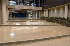 This solid surface looks and wears very similar to terrazzo but was created using the Bomanite Renaissance Deep Grind System and includes a custom mix of individually sourced aggregates, sands, and integral color, the combination of which resulted in this beautiful and refined custom polished concrete flooring.