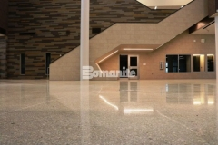 The Bomanite Renaissance Deep Grind System was an ideal choice for Olathe West High School because it created high-end, customized decorative concrete flooring with upfront cost savings and ease of maintenance, making it the right investment for long lasting durability and beauty.