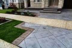 This Bomanite Yorkshire Stone imprinted concrete driveway and patio feature Bomanite Shale Gray Color Hardener and a Gray Release Agent that were chosen to complement the existing concrete walkway while enhancing the home's architecture.