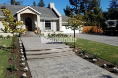 Bomanite Bomacron stamped concrete was installed here by our colleague Heritage Bomanite to create this stunning driveway and walkway and the English Sidewalk Slate imprint pattern that runs the length of the driveway and front entryway is the perfect complement to the European flair of this Fresno, California home.
