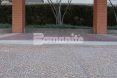 Bomanite Bomacron English Sidewalk Slate imprinted concrete with a Bomanite Sandscape Texture Exposed Aggregate finish was installed at the entrance to the Residence Condominiums to create a hardscape surface that is stylish, functional, and easy to maintain.