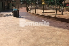 Bomanite Bomacron Regular Slate imprinted concrete was installed here to create a durable decking surface with texture and dimension that adds distinctively beautiful detail to the hardscape.