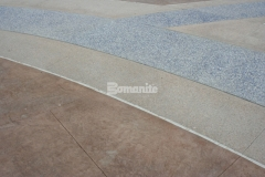 This beautiful display of decorative concrete features multiple Bomanite Systems, including 1,700 SF of Bomanite Slate Texture imprinted concrete that surrounds bands of Bomanite Sandscape Texture and Bomanite Revealed to create a hardscape surface with unique architectural detail and extreme durability.