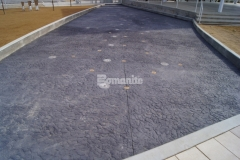 The Bomanite Chipped Shale Imprint pattern was utilized at Redbud Festival Park to create a decorative concrete riverbed and splashpad, adding durability and unique design detail that the Owasso community can enjoy.