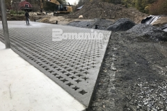 This charming hardscape surface features Bomanite Grasscrete pervious concrete and was perfect for this site to create access for large delivery vehicles while providing a permanent solution for stormwater management.