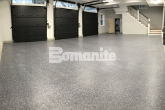Our colleague, Premier Concrete Construction, expertly utilized the Bomanite Broadcast Flake Toppings System to provide a solution to a badly poured concrete garage foundation and the homeowner can now rest assured that this protective flooring surface will stand up to long term wear and tear.