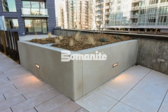 Bomanite Micro-Top ST is a specialized concrete option that can cover virtually any surface and was applied here as a decorative overlay to create planter boxes that are durable and versatile enough to withstand weather while providing a sandscape texture with beautiful coloration.