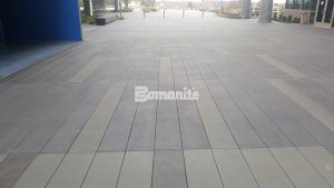 Bomanite Sandscape Texture decorative concrete catches the visitors eye at Garmin Expansion Pedestrian Plaza in Olathe, KS.