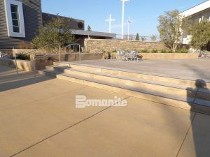 A multi-purpose decorative concrete plaza using Bomanite Exposed Aggregate Systems with Bomanite Sandscape Texture and Bomanite Sandscape Refined Antico in other parts of the plaza at CrossCity Church, formerly known as Northside Church, in Fresno, CA.