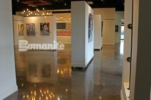Bomanite Custom Polishing System using Bomante Patene Teres in Bomanite Black Orchit creates stunning decorative concrete flooring at The American Fallen Soldiers Project Gallery.