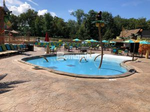 Kid friendly lagoon at Canobi Lake Park Castaway Island Expansion in Salem, NH using Bomanite Imprint Systems with Bomacron Patterns installed by Harrington Bomanite.