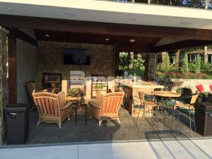 The Outdoor Kitchen inside the cabana of the Backyard Resort created by Concrete Arts featuring Bomanite Imprinted Concrete Systems and Bomanite Topping Systems Overlay - Bomamite Thin Set.
