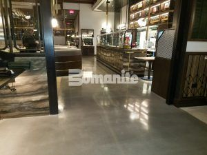Wraparound view of Bomanite Decorative Concrete Bomanite Modena SL Custom Polished Concrete Floors installed at Angeline by Michael Symon restaurant located in the Borgata Hotel Casino and Spa in Atlantic City.