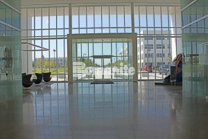 View of the front from the lobby of Cypress Waters Office Complex in Coppel, Texas, using Bomanite VitraFlor Custom Polishing Decorative Concrete flooring, installed by Texas Bomanite.