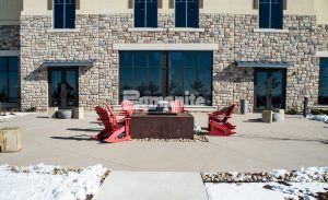 Outdoor seating area highlighting the decorative concrete including Bomanite Imprint and Bomanite Sandscape Texture at the Gaylord Rockies Resort and Convention Center in Aurora, CO installed by Colorado Hardscapes.