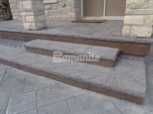 Close up of the steps and porch featuring Bomanite Imprint Systems decorative concrete using Yorkshire Stone Pattern with Bomanite Shale Gray Color Hardener installed at a residence in Burlington, Ontario, by Bomanite Toronto located in Vaughn, Ontario near Toronto Canada.
