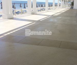 Closer up view towards the beach of the walkway of Bomanite Revealed Exposed Aggregate Systems decorative concrete installed at Westchester CC Beach Club by Beyond Concrete of Keyport, NJ.