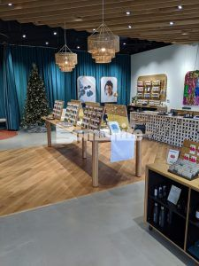 Long view of displays and Christmas tree at Nickel & Suede highlighting Bomanite Modena SL Custom Polished decorative concrete overlay installed by Musselman & Hall Contractors, LLC in Kansas City, MO.