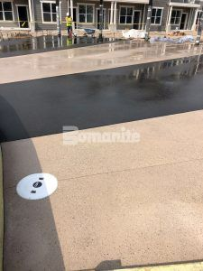 During construction of the pool deck area at Icon Apartment Homes at Ferguson Farm in Bozeman, MT, installed by Bomanite licensee Architectural Concrete & Design using Bomanite Exposed Aggregate Systems with Bomanite Sandscape Texture and Bomanite Revealed.