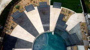Overhead view pool deck area at Icon Apartment Homes at Ferguson Farm in Bozeman, MT, installed by Bomanite licensee Architectural Concrete & Design using Bomanite Exposed Aggregate Systems with Bomanite Sandscape Texture and Bomanite Revealed.